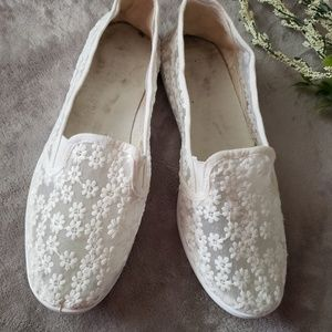 White lacy slide on sneakers. Size 10